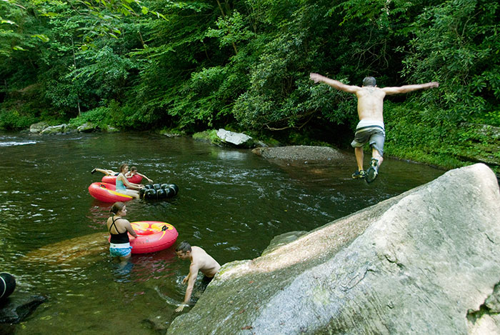 Jumping from rock into a Deep Creek swimming hole